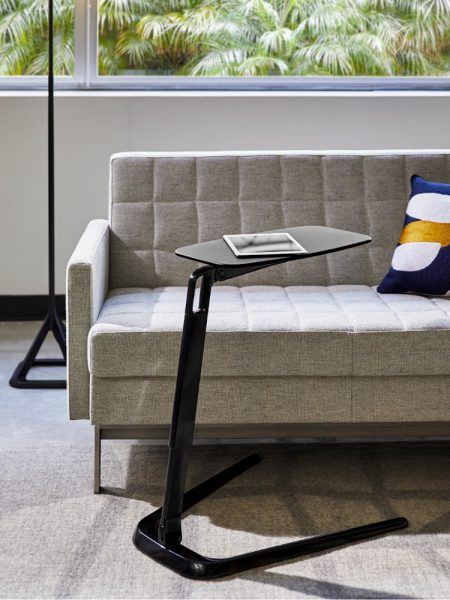 Modern couch and side table with a tablet on it