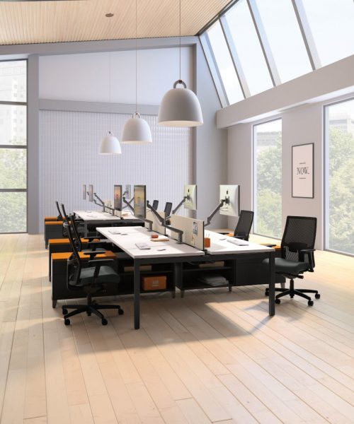 modern shared office space with big windows and hanging pendant lights