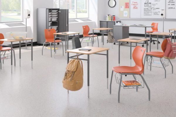 orange chairs with desks in classroom