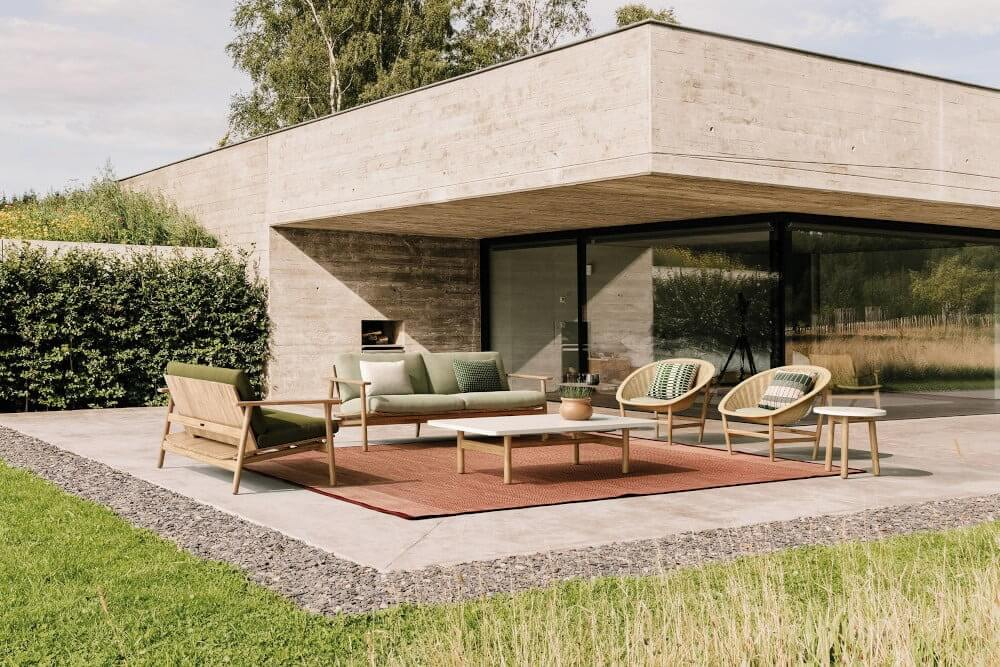 outdoor lounge set outside private modern residence