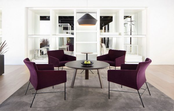 four purple armchairs around a coffee table