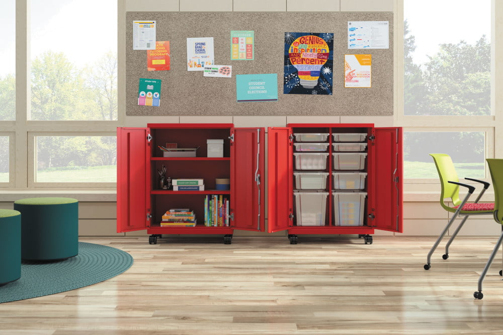 red storage unit in a classroom with pinboard above it